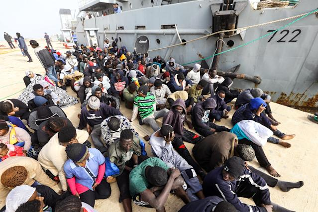 <p>African migrants rescued from a ship off the coast of Zawiyah, about 45 kilometres west of the Libyan capital Tripoli, sit at the dock at the capital's naval base on March 10, 2018. (Photo: Mahmud Turkia/AFP/Getty Images) </p>