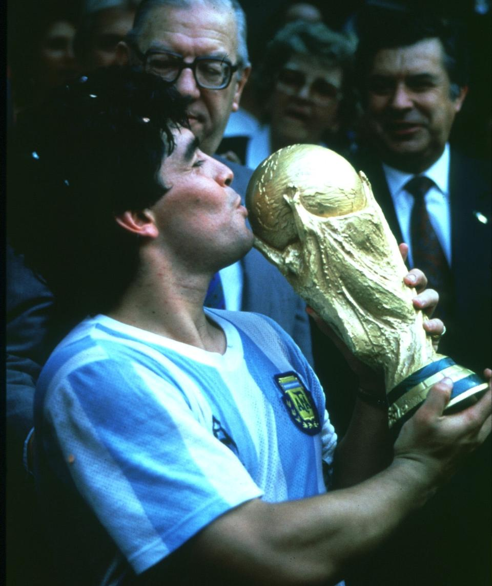 Maradona kisses the World Cup trophy after single-handedly leading Argentina to their 1986 triumph. (PHOTO: Horstmüller/ullstein bild via Getty Images)