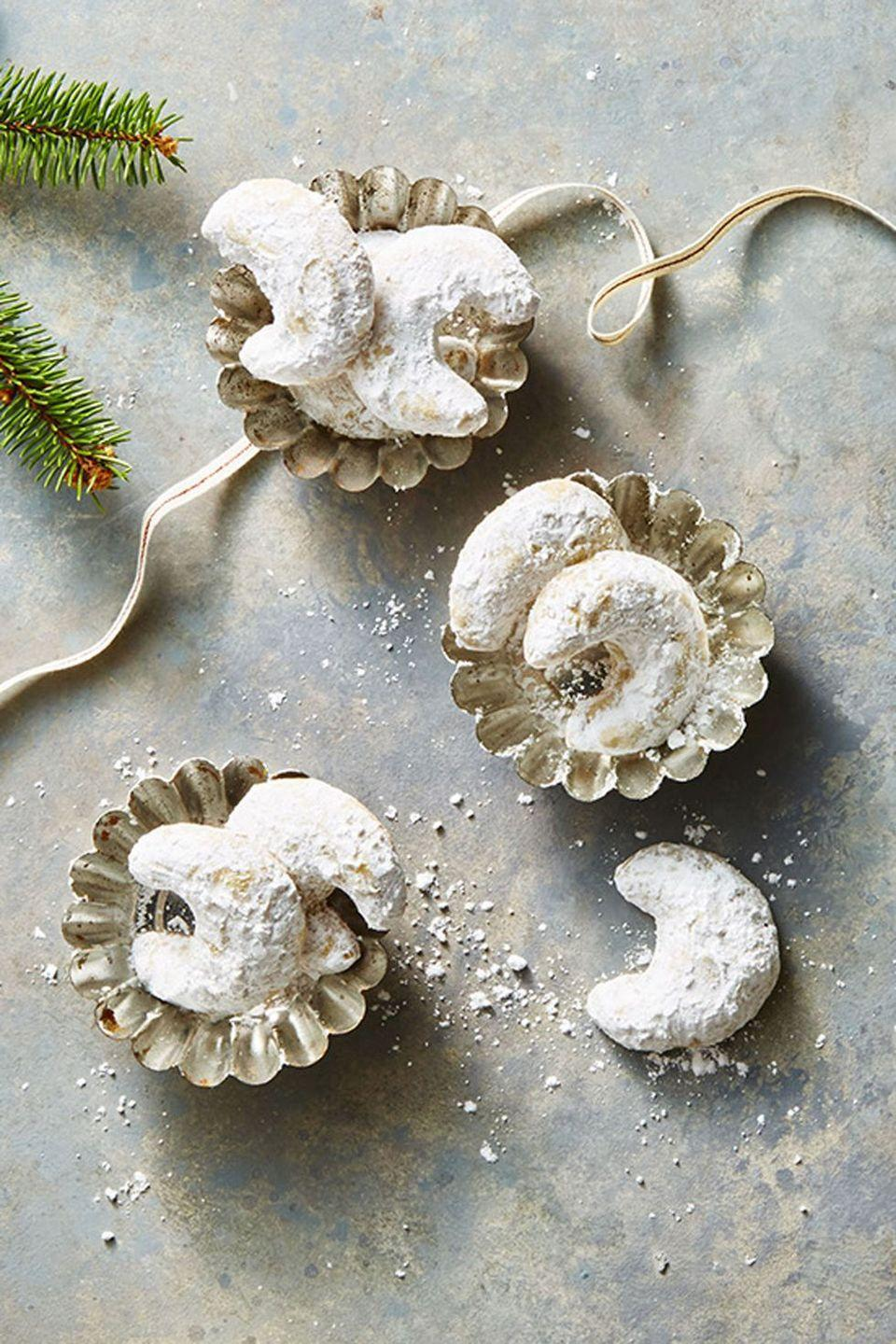 """<p>Full of ground walnuts, cardamom and cinnamon, these snowy treats are perfect for the holidays.</p><p><em><a href=""""https://www.goodhousekeeping.com/food-recipes/dessert/a46911/walnut-crescent-cookies-recipe/"""" rel=""""nofollow noopener"""" target=""""_blank"""" data-ylk=""""slk:Get the recipe for Walnut Crescent Cookies »"""" class=""""link rapid-noclick-resp"""">Get the recipe for Walnut Crescent Cookies »</a></em></p>"""