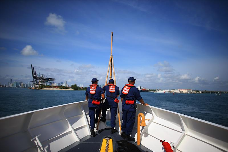 United States Coast Guard personnel are seen on their boat as they arrive back in Miami Beach on October 17, 2012