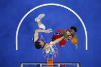 Philadelphia 76ers' Joel Embiid, right, tries to get a shot past Dallas Mavericks' Boban Marjanovic during the first half of an NBA basketball game, Thursday, Feb. 25, 2021, in Philadelphia. (AP Photo/Matt Slocum)