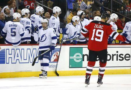 Dec 3, 2018; Newark, NJ, USA; Tampa Bay Lightning center Tyler Johnson (9) celebrates after scoring a goal against the New Jersey Devils during second period at Prudential Center. Mandatory Credit: Noah K. Murray-USA TODAY Sports