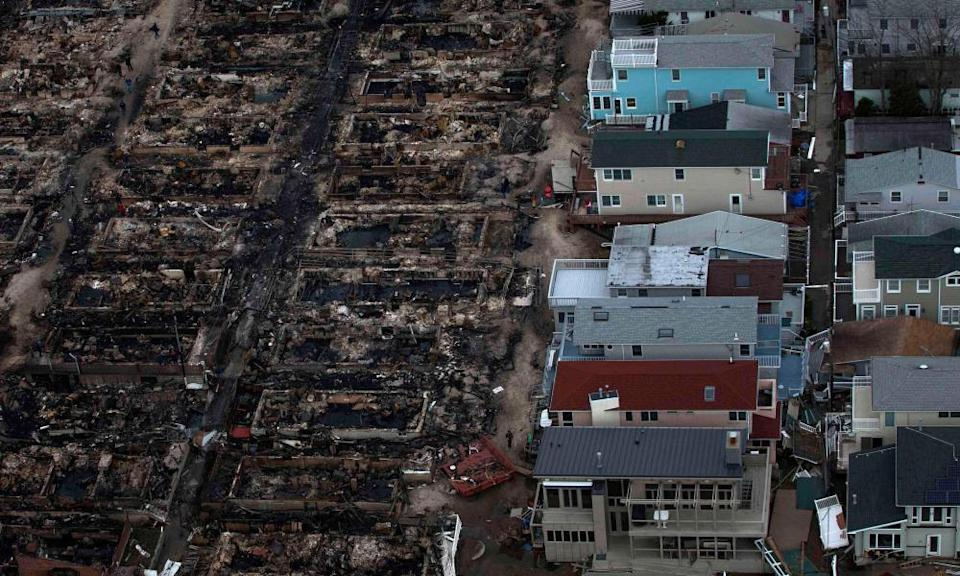 Burned houses are seen next to those which survived in Breezy Point, a neighborhood located in the New York City borough of Queens, after they were devastated by Hurricane Sandy October 31, 2012.