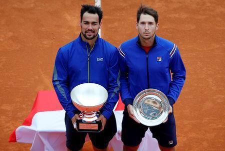 Tennis - ATP 1000 - Monte Carlo Masters - Monte-Carlo Country Club, Roquebrune-Cap-Martin, France - April 21, 2019 Italy's Fabio Fognini poses with Serbia's Dusan Lajovic as they pose with the winner and runner up trophies after the final REUTERS/Jean-Paul Pelissier