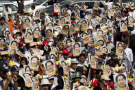 FILE - In this Dec. 10, 2019, file photo, supporters holding portraits of Myanmar leader Aung San Suu Kyi march toward City Hall in Yangon, Myanmar. The future of the Myanmar's already-fragile peace process between the military, ethnic armed groups and militias is in question as the military regains control of the country after the Feb. 1, 2021 coup. (AP Photo/Thein Zaw, File)