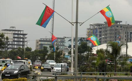 FILE PHOTO: Ethiopia's and Eritrea's flags are displayed on the street ahead of Eritrea's President Isaias Afwerki's visit to Addis Ababa, Ethiopia July 13, 2018. REUTERS/Tiksa Negeri/File Photo