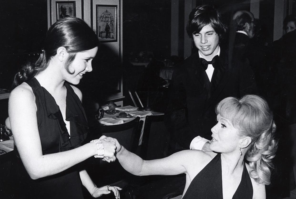 """Carrie Fisher, Todd Fisher and Debbie Reynolds at the opening of """"Irene"""" on March 13,1973, at Minskoff Theater in New York City."""