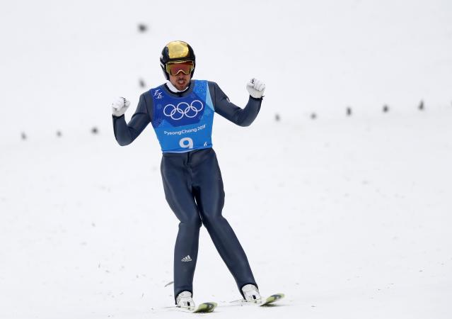 Nordic Combined Events - Pyeongchang 2018 Winter Olympics - Men's Team Gundersen LH Competition - Alpensia Ski Jumping Centre - Pyeongchang, South Korea - February 22, 2018 - Johannes Rydzek of Germany reacts. REUTERS/Kai Pfaffenbach
