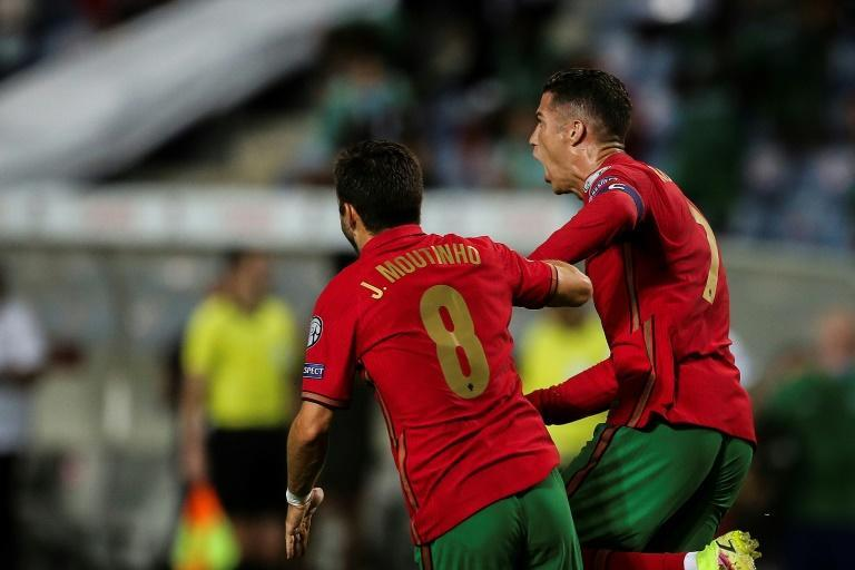 Cristiano Ronaldo (R) scored a dramatic late double to take his tally to 111 international goals (AFP/CARLOS COSTA)