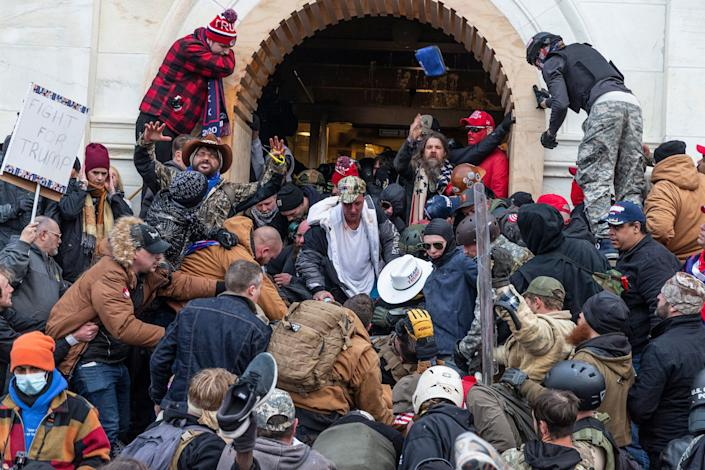 Rioters clash with police as they try to enter the Capitol on Jan. 6. (Photo: Pacific Press via Getty Images)