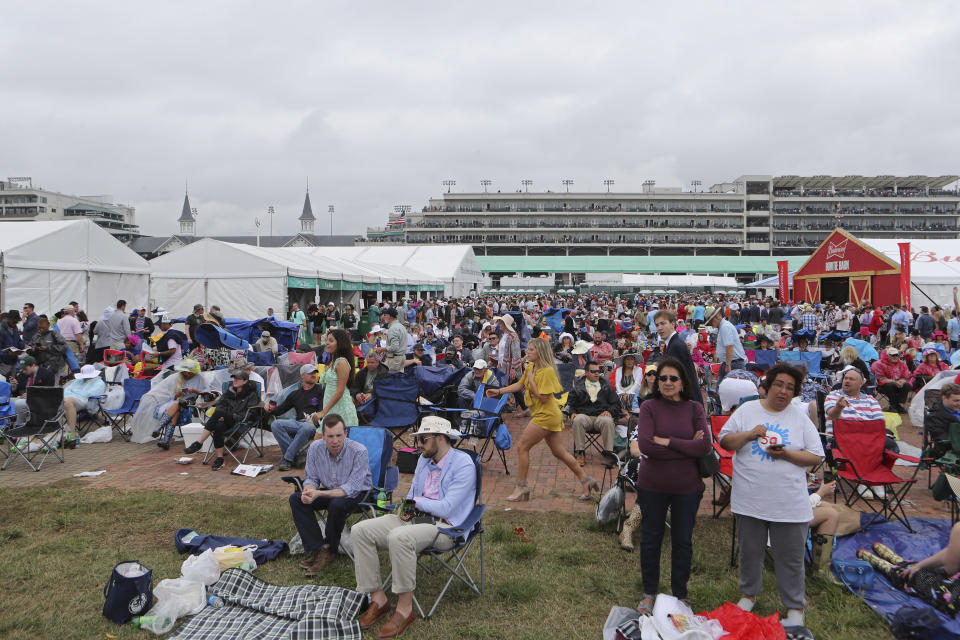 Fans are seen in the infield at Churchill Downs on Kentucky Derby day, Saturday, May 4, 2019, in Louisville, Ky. (AP Photo/Gregory Payan)