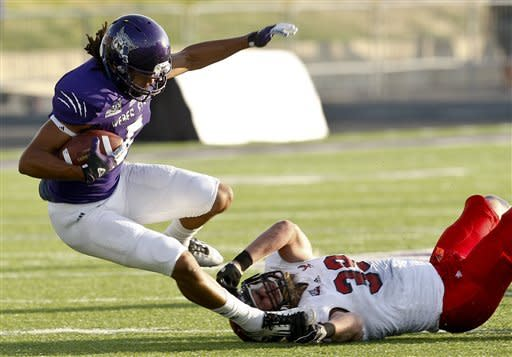 Weber State's Jordan Clemente (5) gets tripped up by Eastern Washington's Ronnie Hamlin (39) during an NCAA college football game in Ogden, Utah, on Saturday, Sept. 22, 2012. (P Photo/Standard-Examiner, Nicholas Draney) TV OUT LOCAL TV OUT MANDATORY CREDIT