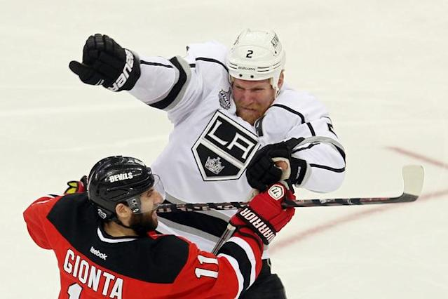 NEWARK, NJ - JUNE 09: Matt Greene #2 of the Los Angeles Kings collides with Stephen Gionta #11 of the New Jersey Devils during Game Five of the 2012 NHL Stanley Cup Final at the Prudential Center on June 9, 2012 in Newark, New Jersey. (Photo by Jim McIsaac/Getty Images)