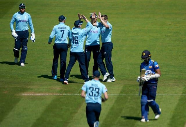 England celebrate after Sri Lanka's Dasun Shanaka is caught out by Jonny Bairstow, bowled by Chris Woakes