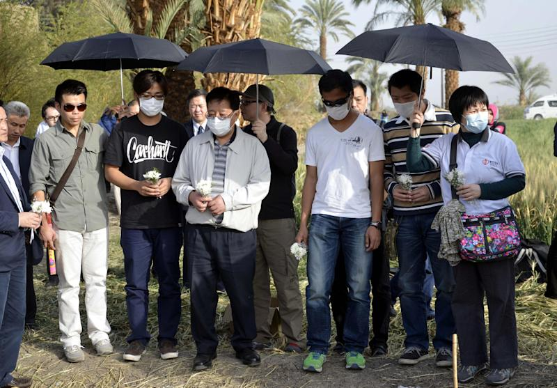 Relatives of tourists from Hong Kong killed in a hot air balloon accident gather at the site during a memorial ceremony for the victims in Luxor, Egypt, Saturday, March 2, 2013. Nineteen people were killed on Tuesday, Feb. 26, 2013 in what appeared to be the deadliest hot air ballooning accident on record. The balloon was carrying 20 tourists from France, Britain, Belgium, Japan, Hong Kong, and an Egyptian pilot.(AP Photo/Ibrahim Zayed)