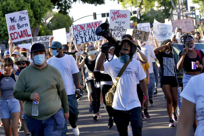 New coronavirus cases more than doubled in Arizona over the past two weeks, and health experts are warning that George Floyd protests, including this one in Tempe, could fuel new spikes. (AP Photo/Matt York)