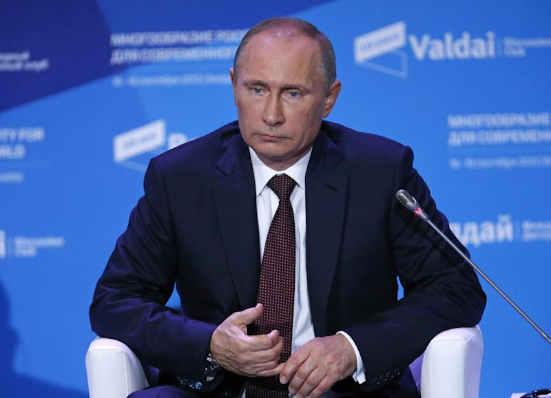 Russian President Vladimir Putin listens to a question during the final plenary meeting of the Valdai International Discussion Club in the Novgorod Region, on the banks of Lake Valdai, Russia, Thursday, Sept. 19, 2013. President Vladimir Putin says that Russia has strong grounds to believe that Syrian rebels were responsible for the country's chemical attack. (AP Photo/Alexander Zemlianichenko, pool)