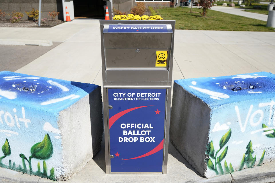"""FILE - In this Oct. 16, 2020, file photo, a ballot drop box is shown where voters can drop off absentee ballots instead of using the mail in Detroit. President-elect Joe Biden shored up the Democrats' """"blue wall,"""" — more sturdily in Michigan, more tenuously in Pennsylvania and Wisconsin — to rebuild the party's path back to the White House. (AP Photo/Carlos Osorio, File)"""