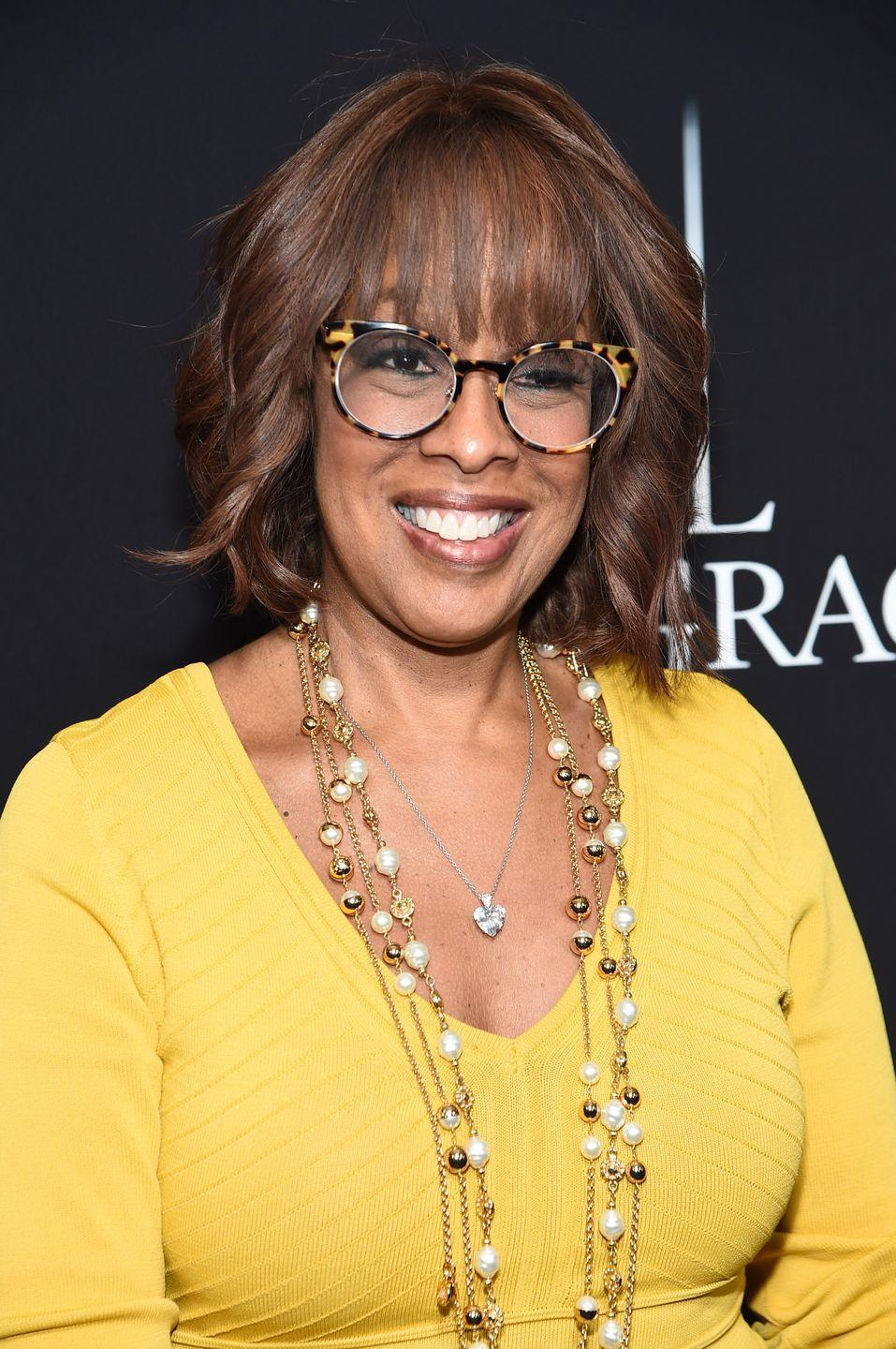 <p><strong>Gayle King's</strong> chocolatey brown hair has thin chestnut highlights that brighten it up. This color looks great with soft bangs like hers. </p>