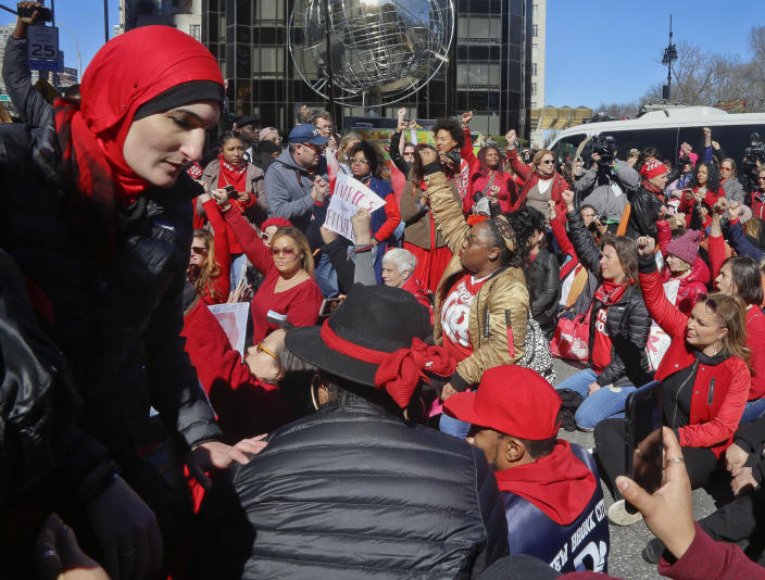FILE - This March 8, 2017, file photo shows civil rights leader and activist Linda Sarsour, far left, during the International Women's Day rally and sit-down protest outside Trump International Hotel at Columbus Circle, in New York. Conflicts over control, inclusivity and alleged anti-Semitism mean that women protesting on the second anniversary of the Women's March on Washington will have competing demonstrations Saturday, Jan. 19, 2019, in New York City. (AP Photo/Bebeto Matthews, File)