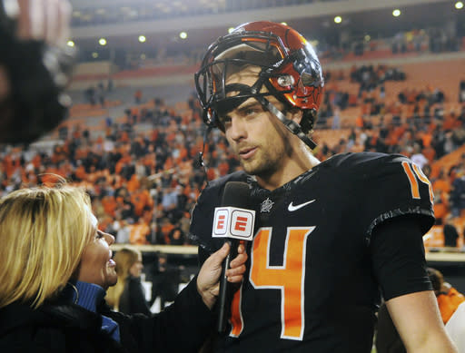 Taylor Cornelius led Oklahoma State to an upset win over West Virginia that clinched bowl eligibility for the Cowboys. (AP Photo/Brody Schmidt)