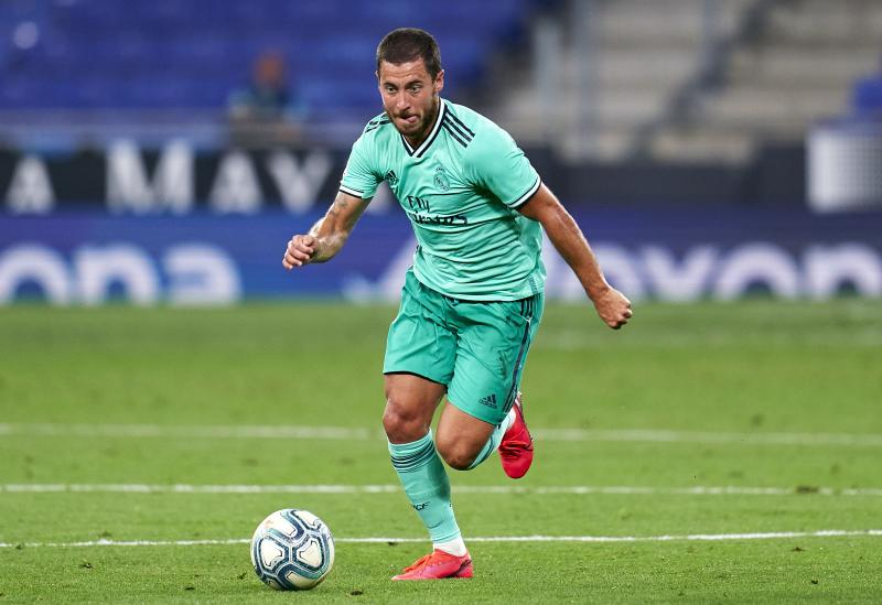 BARCELONA, SPAIN - JUNE 28: Eden Hazard of Real Madrid runs with the ball during the Liga match between RCD Espanyol and Real Madrid CF at RCDE Stadium on June 28, 2020 in Barcelona, Spain. (Photo by Pedro Salado/Quality Sport Images/Getty Images)