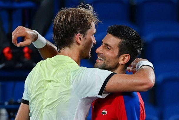 PHOTO: Serbia's Novak Djokovic congratulates Germany's Alexander Zverev for winning their Tokyo 2020 Olympic Games men's singles semifinal tennis match at the Ariake Tennis Park in Tokyo on July 30, 2021. (Vincenzo Pinto/AFP via Getty Images)