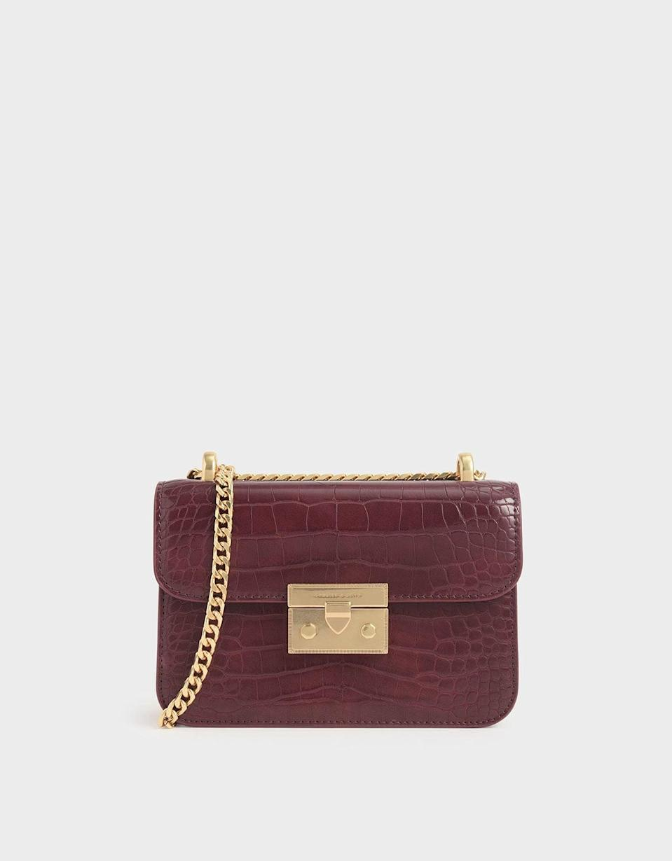 <p>You can't go wrong with this polished <span>Charles &amp; Keith Croc-Effect Boxy Chain Strap Bag</span> ($59).</p>