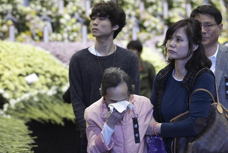 A woman cries as she pays tribute to the victims of the sunken ferry Sewol at a group memorial altar in Ansan, South Korea, Saturday, May 3, 2014. More than 300 people are dead or missing in the disaster that has caused widespread grief, anger and shame. (AP Photo/Ahn Young-joon)
