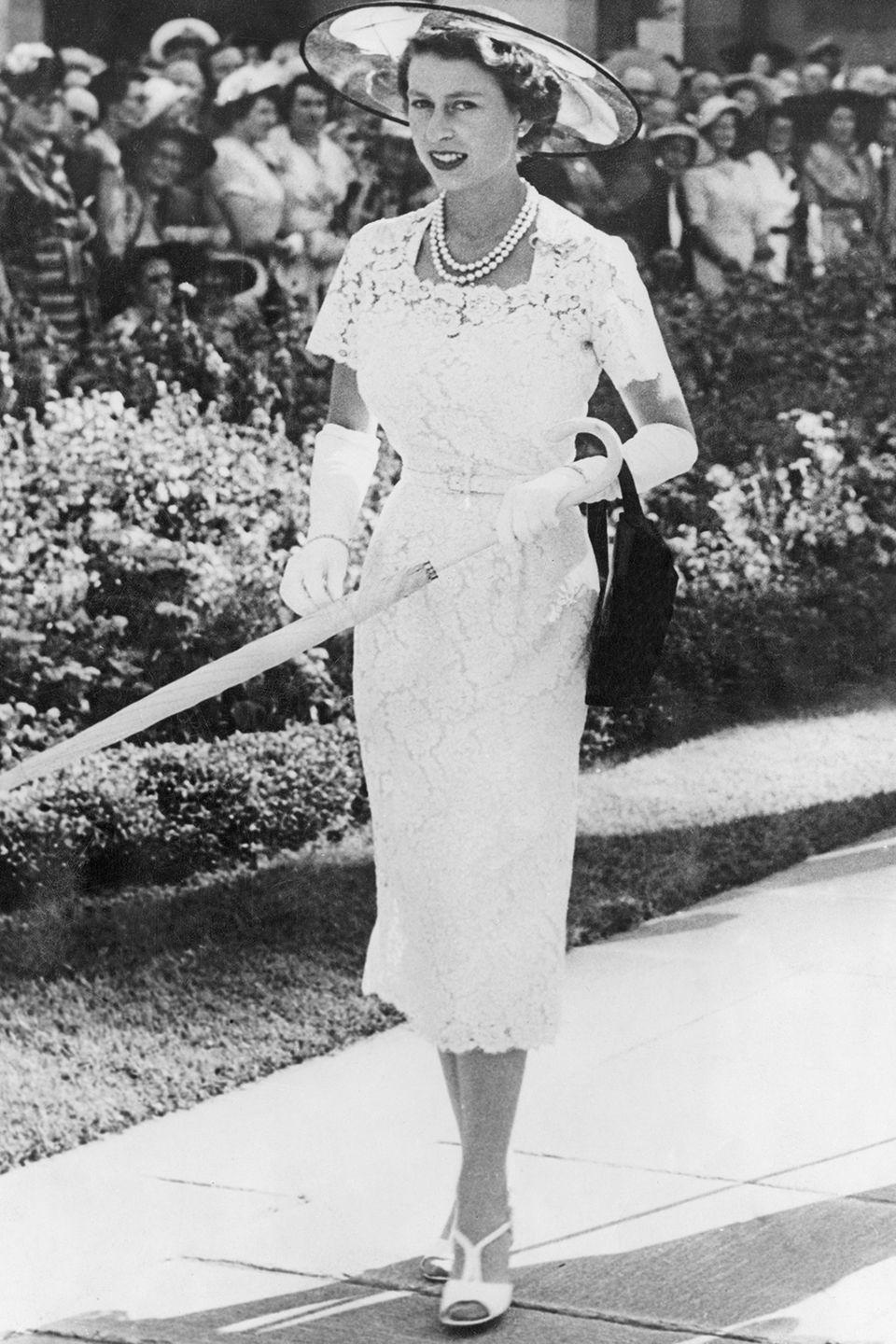 <p>The new monarch attends a garden party in Sydney, Australia wearing a modest white, lace dress with gloves. Elizabeth had only been the Queen for two years in 1954.</p>