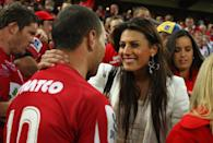 Quade Cooper of the Reds embraces his girlfriend, Australian Olympic swimmer Stephanie Rice after winning the 2011 Super Rugby Grand Final match between the Reds and the Crusaders at Suncorp Stadium on July 9, 2011 in Brisbane, Australia. (Photo by Cameron Spencer/Getty Images)