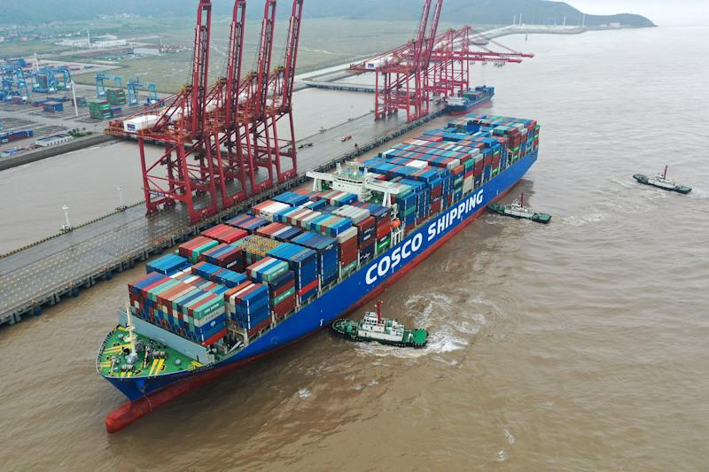 ZHOUSHAN, CHINA - SEPTEMBER 01: Aerial view of a container ship from Cosco France using tugs at the port of Ningbo-Zhoushan September 1, 2019 in Zhoushan, Zhejiang Province China. The container ship Cosco France, coming from Singapore, will unload 8,015 containers with twenty feet equivalent unit (TEU) in Ningbo-Zhoushan port. (Photo by Yao Feng / VCG via Getty Images)