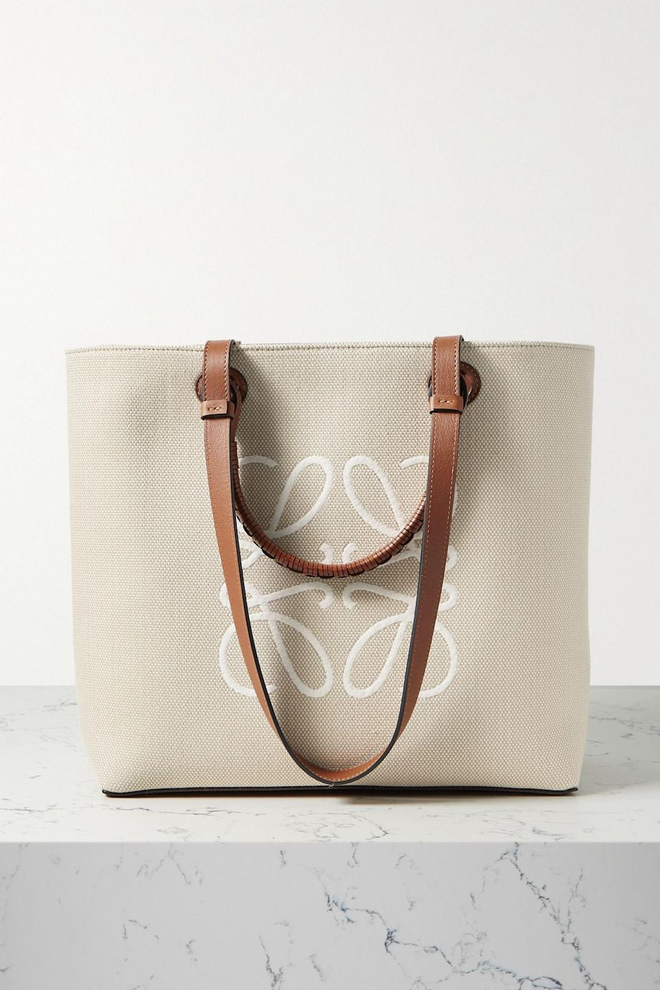 """<p><strong>Loewe</strong></p><p>net-a-porter.com</p><p><strong>$1850.00</strong></p><p><a href=""""https://go.redirectingat.com?id=74968X1596630&url=https%3A%2F%2Fwww.net-a-porter.com%2Fen-us%2Fshop%2Fproduct%2Floewe%2Fanagram-medium-leather-trimmed-embroidered-canvas-tote%2F1325354&sref=https%3A%2F%2Fwww.harpersbazaar.com%2Ffashion%2Ftrends%2Fg36053973%2Fgift-ideas-for-grandma%2F"""" rel=""""nofollow noopener"""" target=""""_blank"""" data-ylk=""""slk:Shop Now"""" class=""""link rapid-noclick-resp"""">Shop Now</a></p><p>Grandmas are notorious for carrying bottomless bags with everything anyone would ever need; it might as well be this chic Loewe leather-trim tote.</p>"""