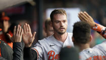 Baltimore Orioles' Trey Mancini is congratulated by teammates after scoring during the third inning of the team's baseball game against the Cleveland Indians, Wednesday, June 16, 2021, in Cleveland. (AP Photo/Tony Dejak)