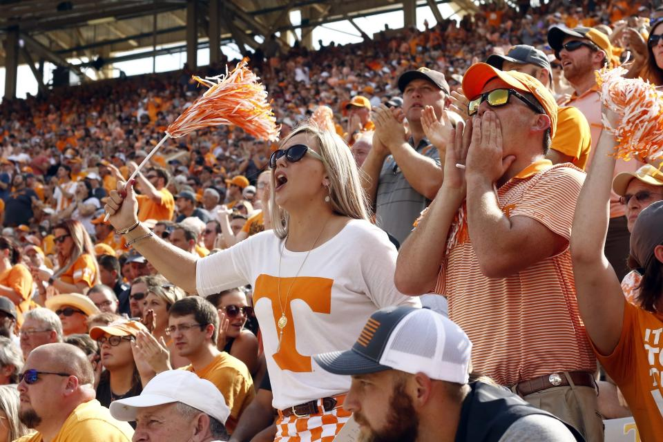 Tennessee fans yell in the first half of an NCAA college football game against South Carolina Saturday, Oct. 14, 2017, in Knoxville, Tenn. (AP Photo/Wade Payne)