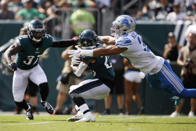 Detroit Lions' Miles Killebrew, right, tackles Philadelphia Eagles' Miles Sanders during the first half of an NFL football game, Sunday, Sept. 22, 2019, in Philadelphia. (AP Photo/Matt Rourke)