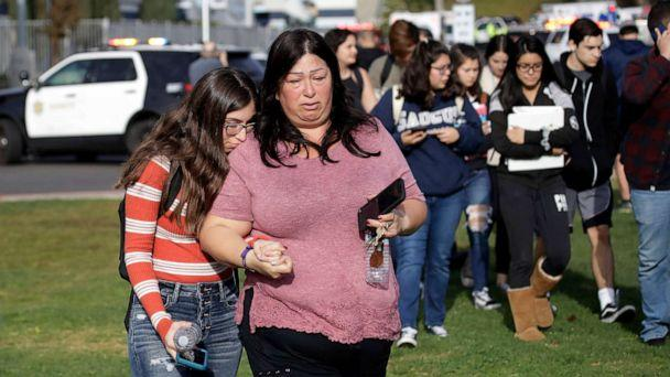 PHOTO: Students are escorted in a single file line as some parents pick them up outside of Saugus High School after reports of a shooting, Nov. 14, 2019, in Santa Clarita, Calif. (Marcio Jose Sanchez/AP)