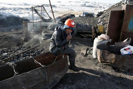 A miner smokes a cigarette at a primitive coal mine outside Ulaanbaatar, Mongolia January 27, 2017. The miners at the Nalaikh coal deposit, outside the Mongolian capital, go as much as 60 meters underground to mine the coal. REUTERS/B. Rentsendorj