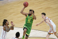 Oregon guard LJ Figueroa (12) shoots over Southern California guard Isaiah White, left, during the first half of a Sweet 16 game in the NCAA men's college basketball tournament at Bankers Life Fieldhouse, Sunday, March 28, 2021, in Indianapolis. (AP Photo/Darron Cummings)