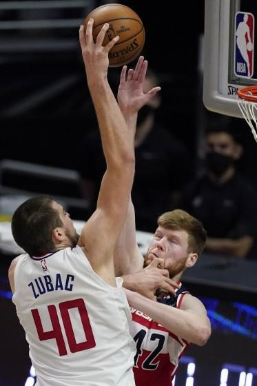 Clippers center Ivica Zubac shoots over Washington forward Davis Bertans on Feb. 23 at Staples Center.