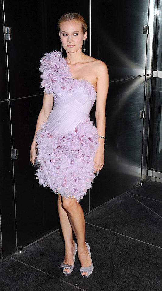 """Budding fashionista Diane Kruger delivered the drama at a recent foster care charity function in an asymmetrical feathered Marchesa frock, $530 bow-adorned Fendi pumps, and a simple yet chic 'do. Johns PkI/<a href=""""http://www.splashnewsonline.com"""" target=""""new"""">Splash News</a> - April 15, 2009"""