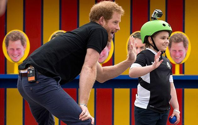 Harry has had plenty of practice with little ones. Photo: Getty