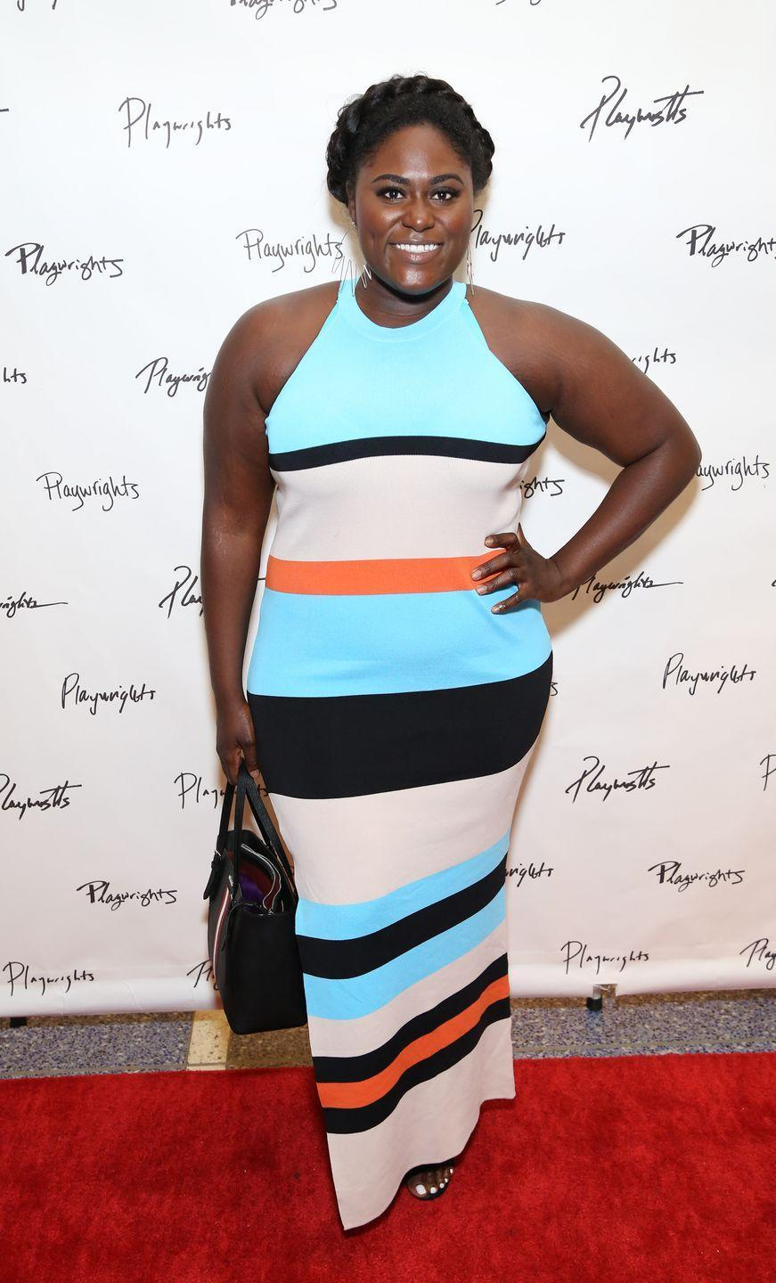 <p><strong>Danielle Brooks</strong> dons a milkmaid braid to create a playful yet chic crown-like look for her hair. </p>