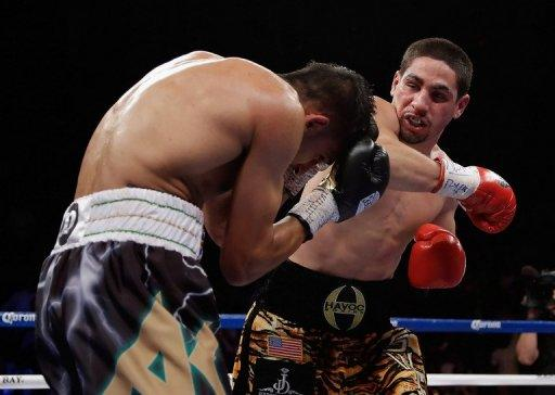 Danny Garcia (right) stopped Amir Khan (left) in the fourth round of the fight