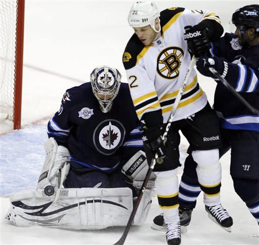Winnipeg Jets goaltender Ondrej Pavelec (31) makes a save as Boston Bruins' Shawn Thornton (22) and Jets' Johnny Oduya (29) battle in front of the net during the second period of an NHL hockey game, Friday, Feb. 17, 2012, in Winnipeg, Manitoba. (AP Photo/The Canadian Press, Trevor Hagan)