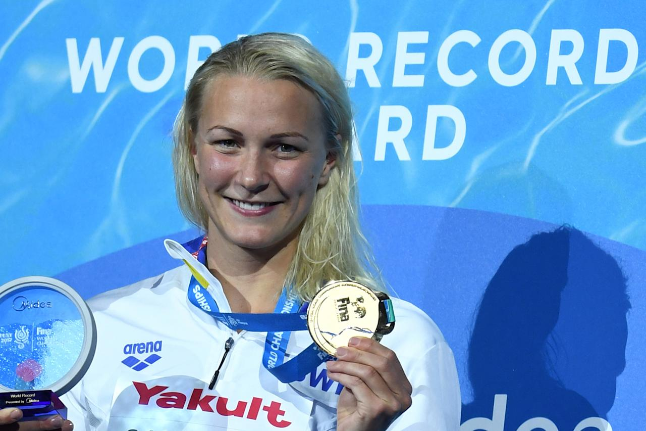 Gold medalist Sweden's Sarah Sjostrom celebrates on the podium of the women's 50m freestyle during the swimming competition at the 2017 FINA World Championships in Budapest, on July 30, 2017. (AFP Photo/FRANCOIS XAVIER MARIT)