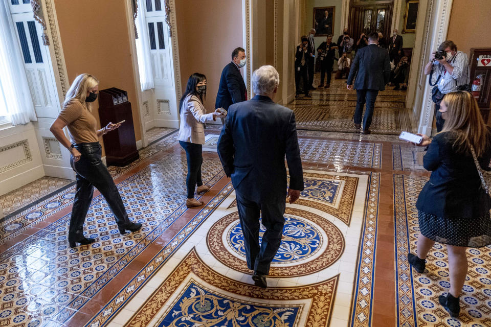 Senate Minority Leader Mitch McConnell of Ky., walks towards the Senate Chamber at the Capitol in Washington, Wednesday, Oct. 6, 2021, as a showdown looms with Democrats over raising the debt limit, at the Capitol in Washington, Wednesday, Oct. 6, 2021. (AP Photo/Andrew Harnik)