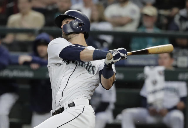 Seattle Mariners' Mitch Haniger watches his two-run home run against the Los Angeles Angels during the fifth inning of a baseball game Tuesday, June 12, 2018, in Seattle. It was Haniger's second home run of the game. (AP Photo/Ted S. Warren)