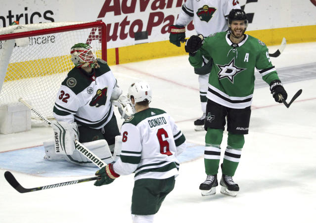 Dallas Stars center Tyler Seguin (91) celebrates his third-period goal against Minnesota Wild goaltender Alex Stalock (32) in an NHL hockey game Saturday, April 6, 2019, in Dallas. (AP Photo/Richard W. Rodriguez)