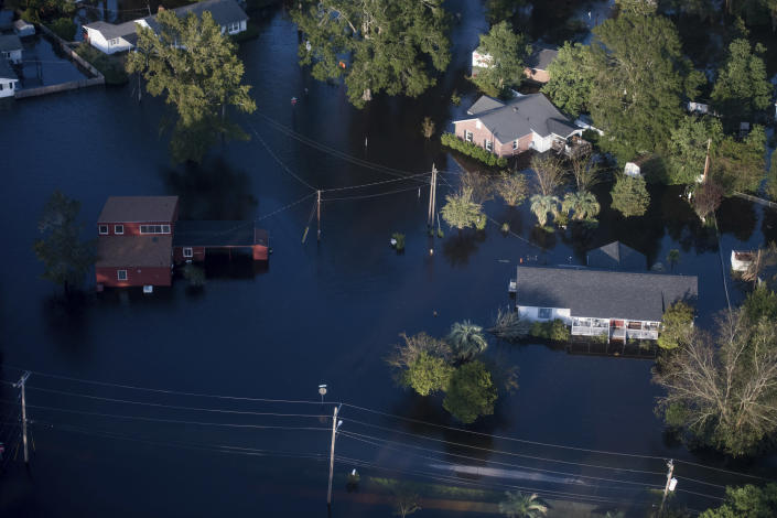 Floodwaters inundate homes after Florence struck the Carolinas, Monday, Sept. 17, 2018, in Conway, S.C. (AP Photo/Sean Rayford)